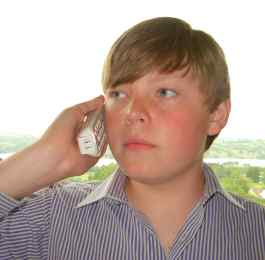 Boy speaking fluently on the phone