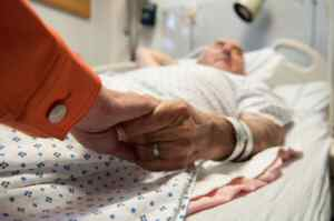 Being cared for in hospital. Man with a visitor