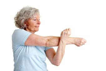 Elderly Lady Doing Her Arm Stretch