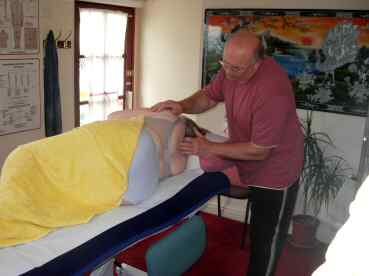 Spinal Touch Treatment on a Pregnant Patient with Back Pain
